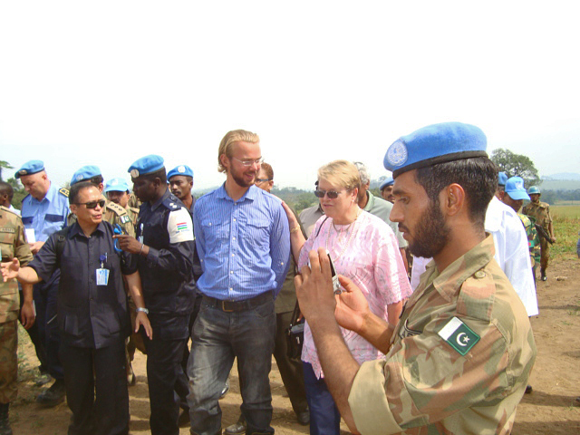 UN staff on rice field
